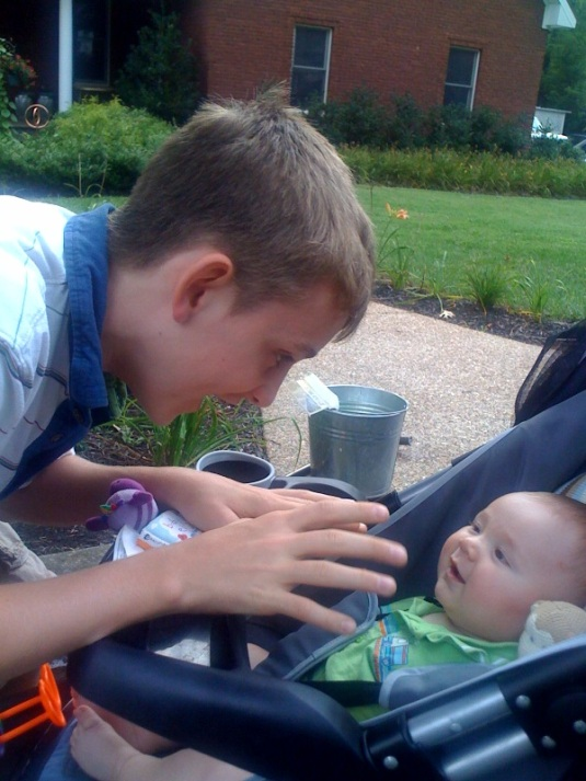 Jack making Leo smile in stroller